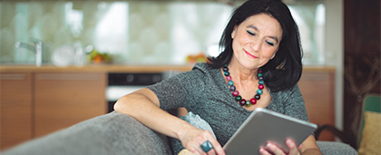 woman reads on a tablet